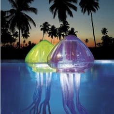 Floating jellyfish pool lights. One of us needs a pool!