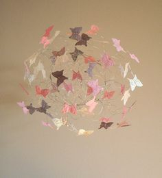 Baby Girl Butterfly Mobile in pink, iridescent and grey and a touch of coral for your Nursery Decor.  Butterflies seem to float and gently swirl