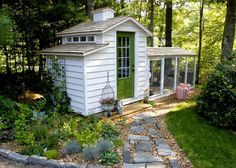 Cottage style chicken coop with run. Loving the bright door.