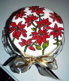 Fondant covered Christmas poinsettia cake I made to look like stain glass.