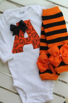 Newborn Baby Girl Outfit for Fall and Halloween SALE PRICE-- Leg warmers and Initial Onesie -- fun orange and black applique on Etsy, $30.00