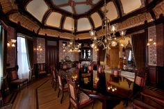 "Mableton's Dining Room, second in scale and importance only to the Main Hall, is an elongated octagon in plan with a double-coved, ribbed ceiling, and shares the Main Hall's ""Stick/Eastlake"" design aesthetic. Dark mahogany millwork frames wall, frieze and ceiling areas filled with gold and metallic accented wallpapers inspired by the Victorian avant-garde designs of Christopher Dresser. #bradburywallpaper"