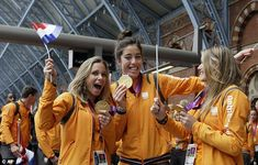 Members of the Netherlands' women's hockey team brandished their gold medals at St Pancras station before they departed.  ......Olympics 2012- London, England