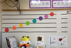 """I want room for a permanent one...Make your own staff on the magnet board.  I used black 1/4"""" ribbon (cheap) and cut magnets that you put on the back of a business card and stuck it on the back.  The """"notes"""" are the same colors as the boomwackers and were cut with a die-cut machine with business card magnets on the back and sharpie solfedge on the front. Easy to move """"do"""" to any line or space."""
