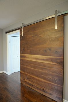Great Solid Walnut Doors  On Modern Barn Track With Horizontal Grain