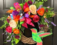 This gorgeous Hummingbird wreath will be a great addition to any front door. It is adorned with a wooden hand-painted hummingbird too! This wreath is constructed on a 18 Round Grapevine Summer Door Wreaths, Holiday Wreaths, Spring Wreaths, Diy Wreath, Grapevine Wreath, Wreath Ideas, Deco Mesh Wreaths, Floral Wreaths, Dollar Tree Decor
