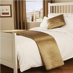 Glossy gold bed runner. http://www.worldstores.co.uk/p/Passion_Gold_Bed_Runner.htm