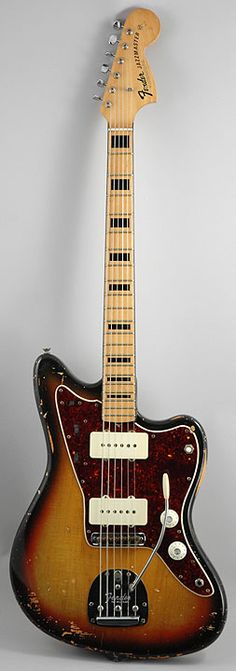 70s Fender Jazzmaster, with black binding on the neck and black block inlays. http://www.pmtonline.co.uk/catalogsearch/result/?q=fender+jazzmaster&order=relevance&dir=desc
