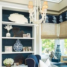 Wouldn't it be nice to work from this office designed by @barclaybutera  #office  #blues #grasscloth #builtins #romans #shelfie #chinoiserie #chandelier #envy
