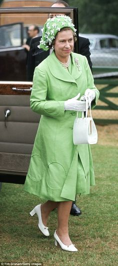 Queen Elizabeth arriving to watch polo at Smiths Lawn Windsor...