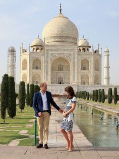 Prince William Photos Photos - Prince William, Duke of Cambridge and Catherine, Duchess of Cambridge pose in front of the Taj Mahal on April 16, 2016 in Agra, India. This is the last engagement of the Royal couple after a week long visit to India and Bhutan that has taken them in cities such as Mumbai, Delhi, Kaziranga, Bhutan and Agra. - The Duke and Duchess Of Cambridge Visit India and Bhutan - Day 7