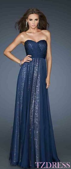 Navy sheer over long strapless sweetheart silver sparkle dress.