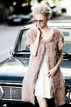 Your perfect white summer dress meets winter. Slip into a fur coat and you're ready for winter.
