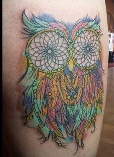 Owl dream catcher rainbow color tattoo. I don't care for tattoos, but I like this design.