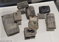Memorials: Mobile phones and other communication devices found in the rubble from the September 11 attacks in 2001 on the World Trade Center are displayed as part of a new exhibit in Washington D.C.