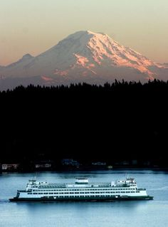 The 4:20 p.m. WA State auto ferry from Seattle to Bremerton passes under Mt. Rainier as the setting sun lights the west side of the mountain.