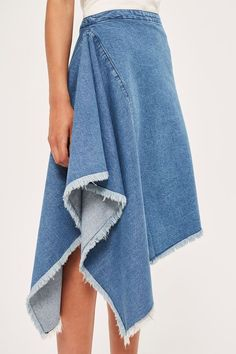 The side drape hem of this denim skirt by Boutique gives your look an unexpected twist. Wear with a slim-fit knitted top for a dose of understated-cool.