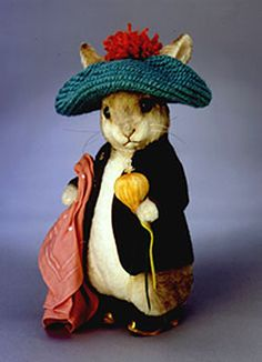 """R. John Wright Dolls - Benjamin Bunny™. 12"""" tall, fully jointed made of mohair with glass eyes. Wearing felt coat, wool tam-o-shanter, wood and leather clogs. Holds a felt/organdy onion and custom printed cotton handkerchief. Date of Release: 2001 Limited Edition 1500."""