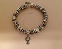 Pandora silver spacer bracelet comprised of different spacers and the hard to find silver venus dangle