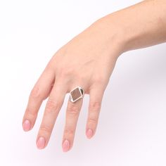 Silver diamond shaped ring with walnut wood. Handcrafted by The Jewelry Story | Atelier Jan Kerkstra and Marion Pannekoek