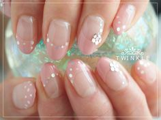 baby pink tips with delicate glitter dot details.