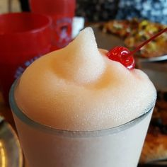 Hideaway Pizza also offers a variety of alcoholic beverages including a full bar. One of the specialty drinks is the Hideaway's Peach Bellini. #hideawaypizza #peachbellini #peachdrink #alcohol #pizzajoint #eatnlr #nlrpizza #arkansasfood