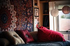 Love the idea of hanging up fabric when you can't paint or wallpaper dorm walls