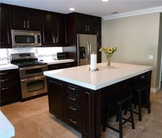 Love The Look Of The White Countertops With The Dark Cabinets
