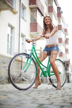 Portrait of a pretty woman on bicycle  Stock Photo