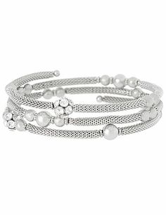 Haute coil bracelet adds a trendy touch to your ensemble with dusted silvertone balls and rhinestone fireballs.  lanebryant.com