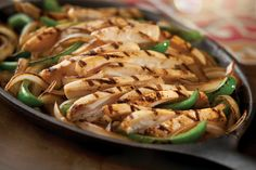 Chicken Fajitas: With grilled onions and peppers.Try it Cadillac style with rice and black beans. #Chilis