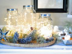 Fill Mason jars, or recycle glass jars, with LED fairy lights and put them out on display to light up your home. Christmas Food Gifts, Christmas Mason Jars, Homemade Christmas Gifts, Christmas Centerpieces, Homemade Gifts, Christmas Lights, Christmas Drinks, Holiday Decorations, Christmas Ideas
