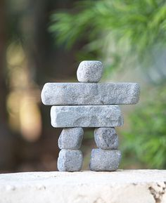 Welcome guests and travelers to your home or garden with a stacked stone garden sculpture inspired by traditional Inuit culture.