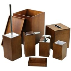 Trendy bathroom accessory set made from wood. Includes soap dish, toothbrush holder, toiletbrush holder, waste bin, tissue box cover, tray, and 2 soap dispensers. Manufactured in Italy. Part of the Gedy Cubico Wood collection.