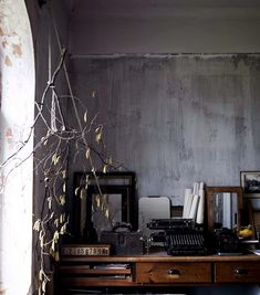 writing room with distressed gray walls