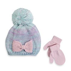 Your child will love stepping out in this stylish Rising Star Knit Bow Hat and Mitten Set. The soft knit set's cozy, multicolor hat features a sparkly bow and fluffy pom-pom on top. Matching pink mittens keep hands warm and complete the sweet look.