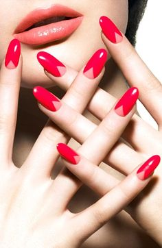 Romantic and flirtatious nail art design. Layer two glossy colors of pink or coral nail polish. Need to learn how to do this look!