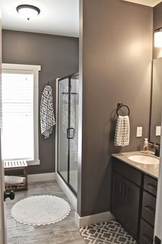 Master Bath Wall Art { -- Faux wood ceramic tile. Walls: Mink, 6004, Sherwin Williams (perfect mix of gray and brown)....white: Dover White.