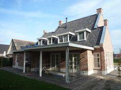 Nieuwbouw woning in klassiek Engelse stijl in de Lutte, ontworpen door Schaepers Bouw- en Ontwerpbureau Oldenzaal en uitgevoerd door bouwbedrijf Punt de Lutte