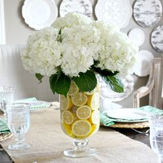 Decorate for Spring! 5 easy ways to fill your home with seasonal joy. Sliced lemons make a beautiful vase filler! Decorate for Spring! 5 easy ways to fill your home with seasonal joy. Sliced lemons make a beautiful vase filler! Lemon Centerpieces, Table Centerpieces For Home, Diy Table, Dining Room Centerpiece, Summer Flower Arrangements, Floral Arrangements, Lemon Kitchen Decor, Driven By Decor, Spring Home Decor