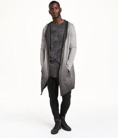 Cardigan in sweatshirt fabric with a hood. Side pockets, raw edges, and no buttons.