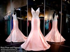 This beautiful gown is definitely a WINNER! I mean, look at that white embellished bodice and blush formfitting mermaid silhouette! Simply stunning and it's at Rsvp Prom and Pageant, your source for the HOTTEST prom and pageant dresses!