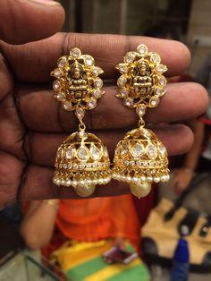Flat diamond lakshmi motif jhumkas with pearl drops