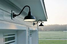 Installed above the garage door, two black gooseneck lights provide the right amount of light in the early morning.