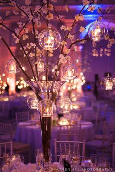 I spy multiple cool ideas here... Would look extra cool with a light up cherry blossom tree in the mix: http://www.flashingblinkylights.com/ledlightuppinkcherryblossomtree-p-2642.html #Centerpieces