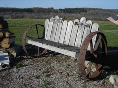 This is a bench my husband and I Built from old wheels . It can be picked up and rolled to anyplace in our yard