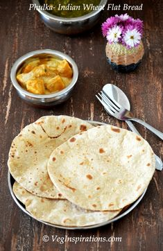 Easy two ingredient Indian wheat flat bread (Phulka) with stepwise pictures and video tutorial. North Indian Recipes, South Indian Food, Indian Food Recipes, Gourmet Recipes, Vegetarian Recipes, Cooking Recipes, Healthy Recipes, Indian Flat Bread, Roti Recipe
