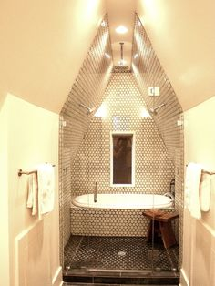 Bathtub In The Shower  -  love the triple shower heads in this one. Seems a bit stark somehow, but love the concept.