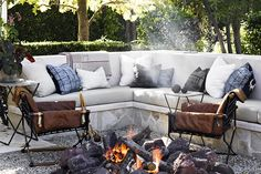 Jeffery Alan Marks, Malibu, California  At the Malibu home of a European couple, located a short walk from the beach, the L.A.-based Jeffrey Alan Marks carried over the unfussy, comfortable yet collected look of the house to an outdoor fire pit. Here, he covered cushions in Indian and Japanese textiles, added two Cleo Baldon campaign-style armchairs with removable leather cushions and, for an extra touch of luxury, an Hermès throw blanket. Photo by Douglas Friedman, courtesy of Rizzoli