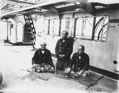 Lauati (aka Lauaki) Namulau'ulu Mamoe (left) and two chiefs aboard German warship taking them to exile in Saipan, 1909. Author Alfred John Tattersall (1861 - 1951)